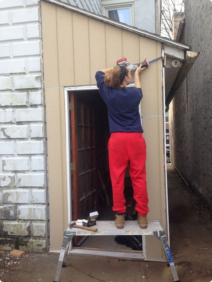 Courtesy of Hannah Wolfrum | Hannah Wolfrum works on the outside back wall.