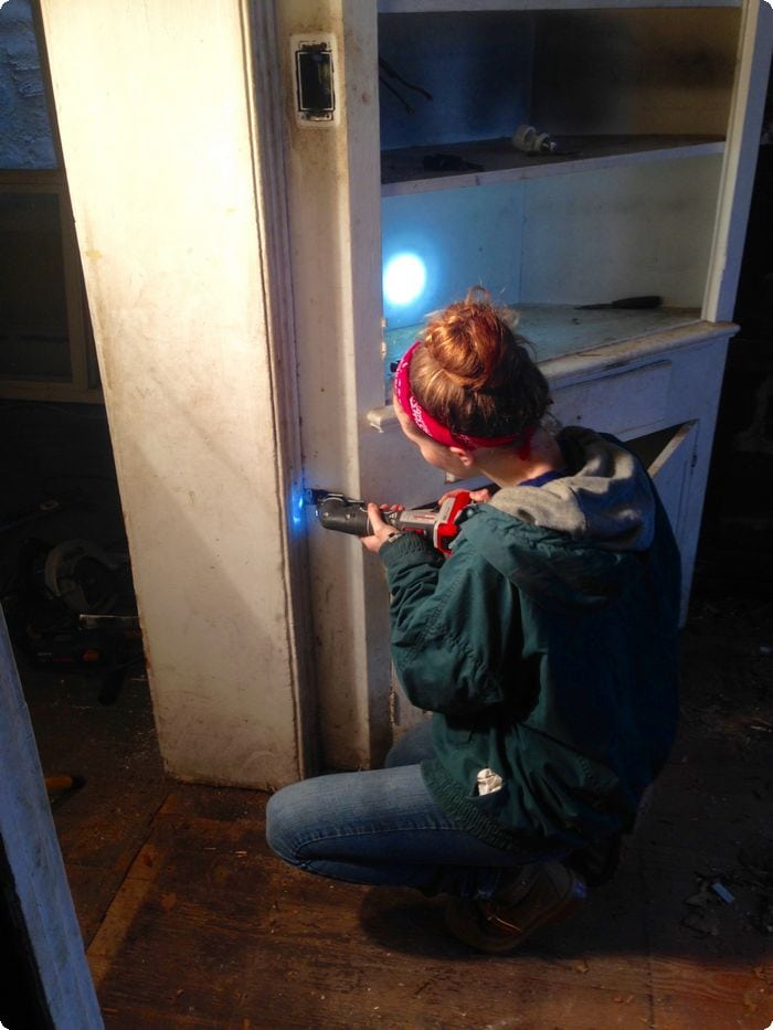 Courtesy of Hannah Wolfrum | Wolfram works on removing a cabinet from the kitchen.